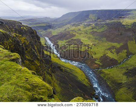 Landscape Valley Of River Fossa With Blue Water Stream And Green Hills And Moss Covered Cliffs, In S