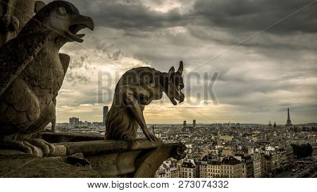 Gargoyles Or Chimeras On The Cathedral Of Notre Dame De Paris Overlooking Paris, France. Gargoyles A