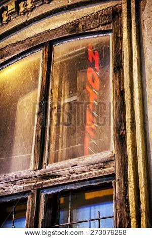 Old Window With Reflective Inscription Hotel, Nitra, Slovakia. Architectural Scene.