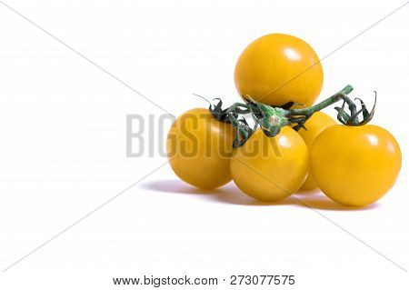 Close-up Of Fresh Yellow Tomatoes Isolated On Clean White Background.  Red Cherry Tomatoes With Gree