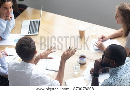 Top View Diverse Businesspeople Negotiating Sitting At Boardroom