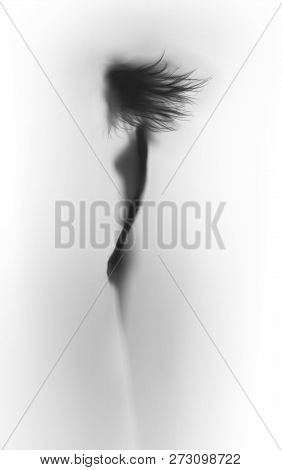 Body Silhouette Of A Beautiful Slim Woman With Long Flying Hair, Abstract.