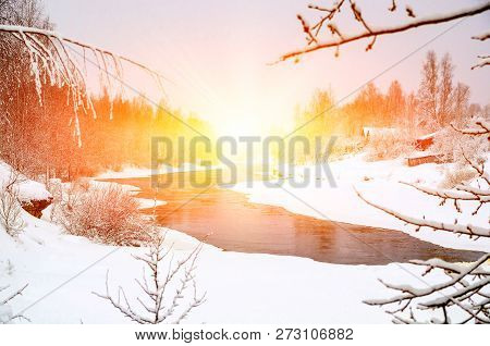 Winter Forest On The River At Sunset. Colorful Landscape With Snowy Trees, Frozen River With Reflect