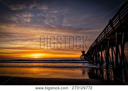 The Setting Sun At The Pier In Imperial Beach, California.