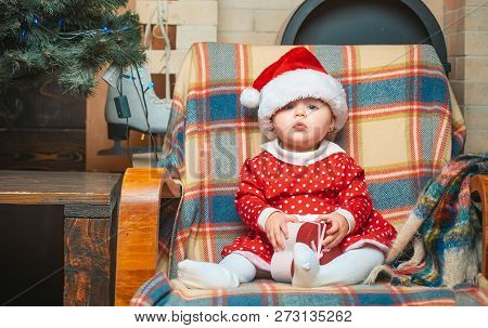 Christmas Babies. Cute Little Baby Child On Christmas Tree Background. Little Baby Girl With A Chris