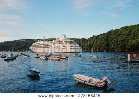 Cruise Ship. Large Luxury White Cruise Ship Liner On Sea Water And Cloudy Sky Background In Fowey