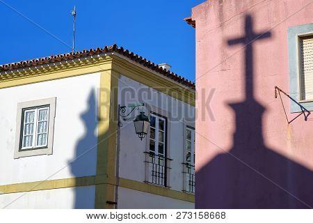 Shadows Of Matriz Church (nossa Senhora Das Dores) On Colorful Facades Inside The Old Town Of Monchi