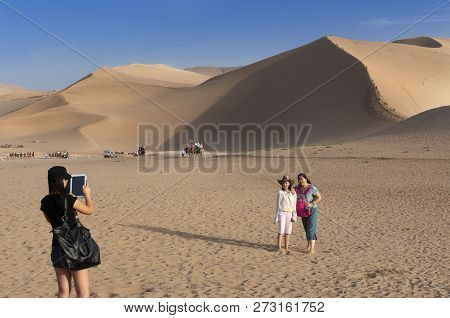 Dunhuang, China - August 8, 2012: Chinese Tourists At The Crescent Moon Lake Near The City Of Dunhua