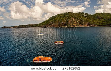 St. Barts, France-november 25. 2015: Sail And Orange Boats Sailing On Sea Water In France On Sunny D