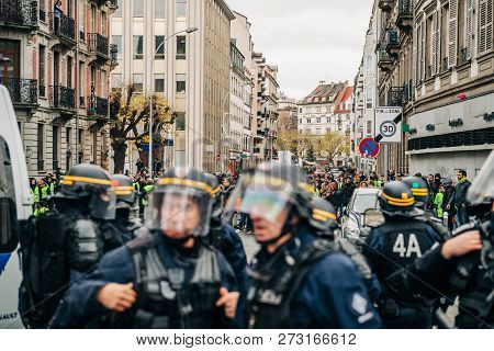 Strasbourg, France - Dec 8, 2018: Police Officers In Front Of The Yellow Vests Movement Protesters O