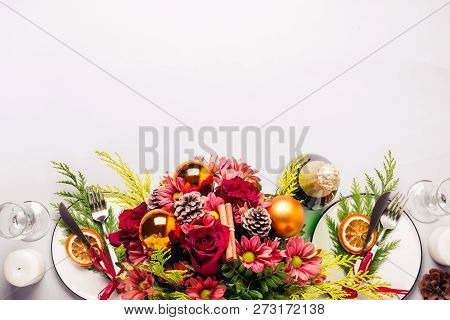Winter Bouquet Of Their Conifers And Flowers. Christmas Table Setting