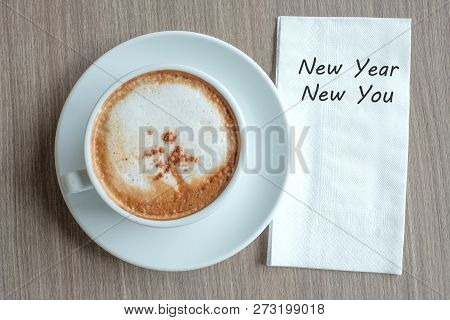 New Year New You Word With Hot Cappuccino Coffee Cup On Table Background At The Morning. New Year Ne