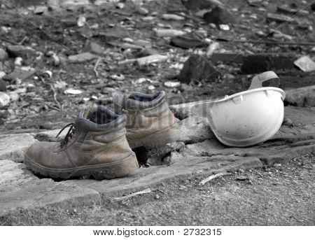 Pair Of Old Work Boots With Builders Hard Hat