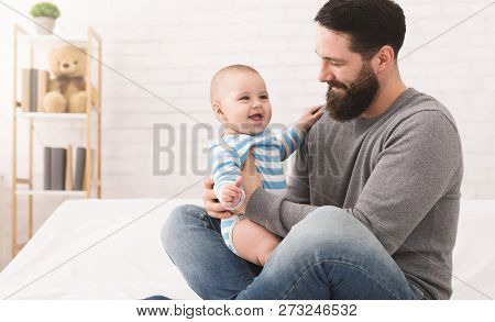 Happy Family. Father Playing With Adorable Baby Son At Home, Copy Space