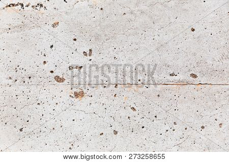 Close Up Details Of Stone Or Masonry On The Side Of A Building. Cracks And Imperfections Of Concrete