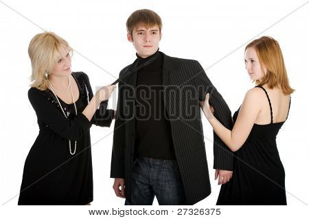Two women pulling a man in opposite sides