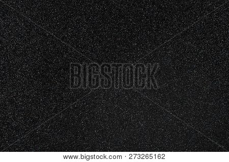 Coal Black Colored Sand Paper Textured Background With Sparkles And Glitters