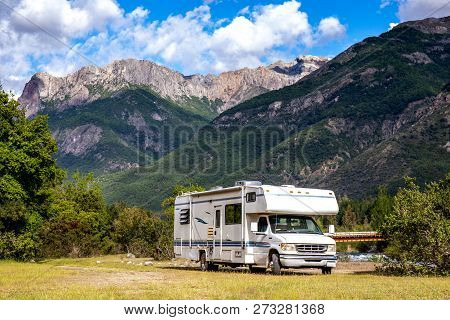 Panoramic View Of Motorhome Rv In Chilean Landscape In Andes. Family Trip Traval Vacation In Mauntai