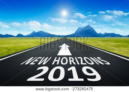 A road to horizon with text new horizons 2019