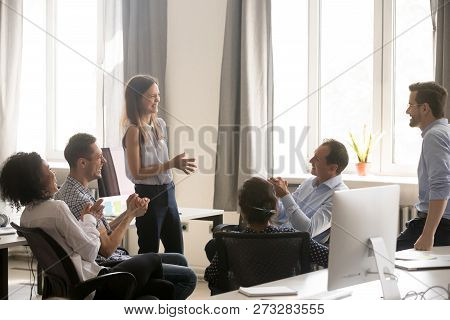 Young Female Coach, Leader Having Fun With Employees, Office Wor