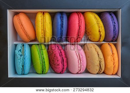 Macarons French Cookies. Macarons Are In A Box On A Marble Background. French Dessert Macarons. Top