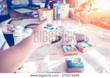 Young Child Boy Is Having Fun While Playing With Stamps And Tempera Paints On Wooden Work Desk With