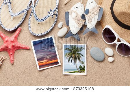 Travel vacation concept with beach hat, sunglasses and weekend photos. Top view. Flat lay. All photos taken by me