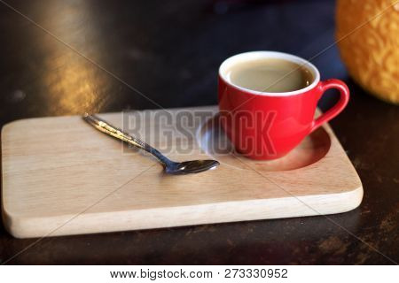 Red Cup Of Coffee On Wooden Tray.