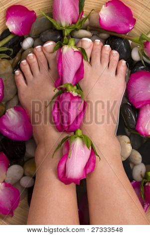 Being pampered by beautiful aromatic pink roses and therapeutic mineral water bath