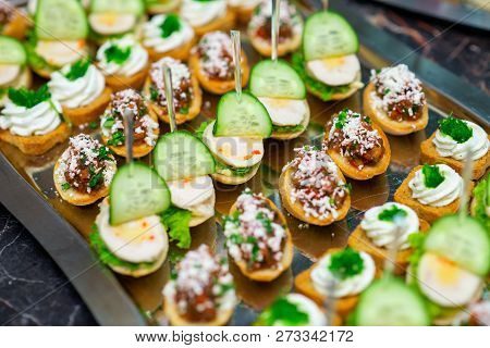 Cold Snacks On The Table Buffet, Canapes At The Banquet
