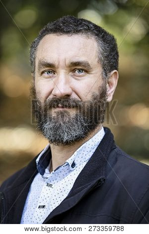 Portrait Of Handsome Mature Man Curly Black And Gray Hair