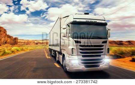 Freight truck on road in valley, front view