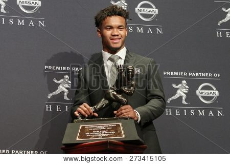 NEW YORK-DEC 8: Oklahoma Sooners quarterback Kyler Murray, winner of the 84th Heisman Trophy, poses to the media on December 8, 2018 at the Marriott Marquis in New York City.
