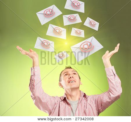 Man with hands up and email messages flying, concept of future technology in delivery of letters.