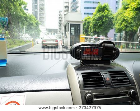 View From Cab With Meter Display Time, Distance And Fare In Dashboard Interior