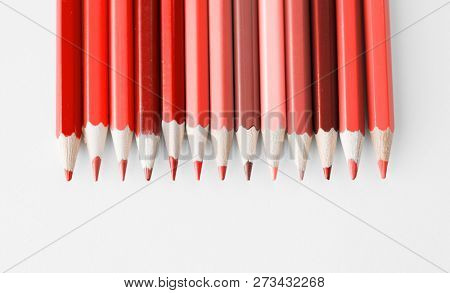 design and creativity concept - many pencils in different shades of color of the year 2019 living coral
