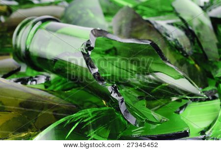 Waste glass. Recicled.Shattered green wine bottle . poster