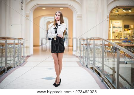 Beautiful Model Brunette Girl Posing In Clothing Store, A New Trend Of Clothes. Banner For A Clothin