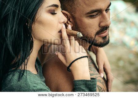 Cuban Cigar. Sensual Latino  Couple. Latin Men Enjoing And Relaxing With Love Women. Couple Enjoy In