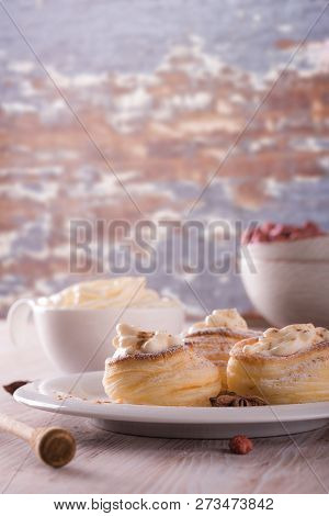 Sweet Dessert From Puff Pastry Filled By Curd Cheese On Wooden Board