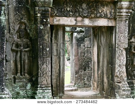 Old Weathered Grey Jungle Ruins With A Carved Statue In Cambodia