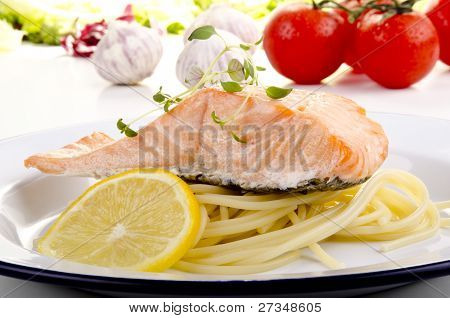 Steamed wild salmon and spaghetti on a plate poster