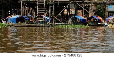 Bright Colourful Little Wooden Boats At A Floating Village On A Lake In Cambodia