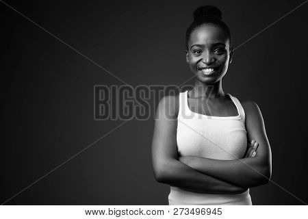 Young beautiful African Zulu woman smiling in black and white poster
