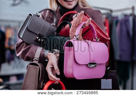 Smiling Successful Owner Of Concept Store Presenting New Leather Bags