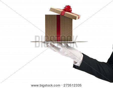 Waiter Holds A Christmas Present In A Tray. Isolated On White Background