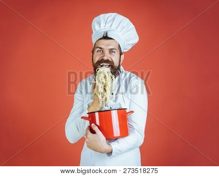 Spaghetti. Happy Chef With Pasta In Hand. Chef Eating Delicious Spaghetti. Cook Eat Pasta. Chief Coo