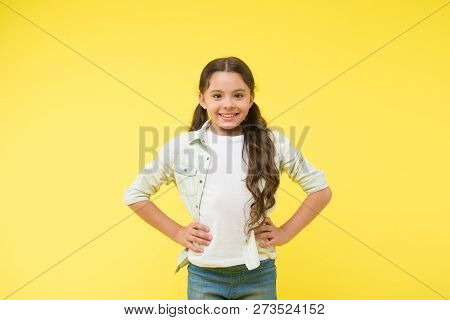 Happy Confident Child Keep Hands On Hips. Cheerful And Confident. Little Girl Cute Smile. Casual Loo