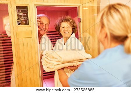 Senior couple relaxes in a sauna at the Wellness Hotel or Seniorenresidenz