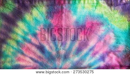 Tie dye fabric. Circular pattern.